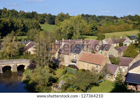 """Aerial view of the village of Saint-Ceneri-le-Gerei, classified """"The Most Beautiful Villages of France"""", with the Sarthe river and the old bridge, department of the Orne, region Basse Normandie - stock photo"""