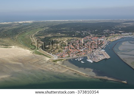 Aerial view of the village of Terschelling, an island in the Waddenzee, Holland. The Waddenzee is on the UNESCO world heritage list. - stock photo