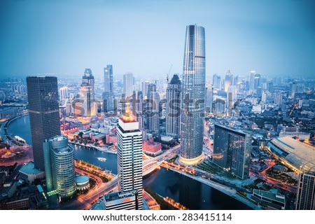 aerial view of tianjin financial district in nightfall, china - stock photo
