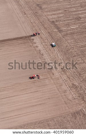aerial view of  tractor on harvest field in Poland