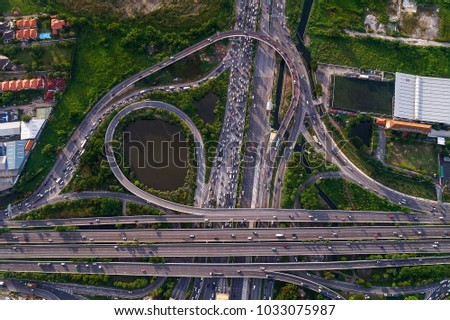 Aerial view of traffic jams at Nonthaburi intersection in the evening, Bangkok.