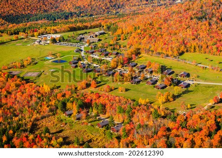 Aerial view of Trapp Family Lodge during peak foliage season, Stowe, Vermont, USA - stock photo
