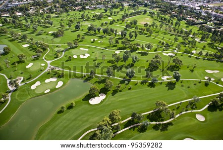 Aerial view of tree lined Golf Course - stock photo