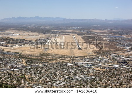 Aerial view of Tucson, Arizona suburbs with military airfield and boneyard in the distance - stock photo