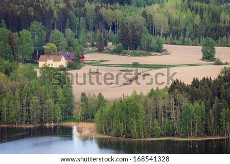 Aerial view of typical Finnish countryside with forests and lakes.