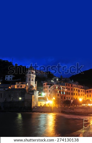 Aerial view of Vernazza - small italian town in the province of La Spezia, Liguria, northwestern Italy. dusk . - stock photo
