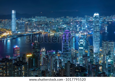 Aerial view of Victoria Harbor of Hong Kong city at night