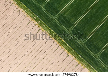 aerial view of village  harvest fields in Poland - stock photo