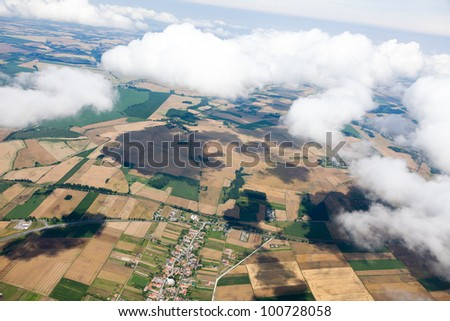 aerial view of village landscape  near Otmuchow town over clouds in Poland - stock photo
