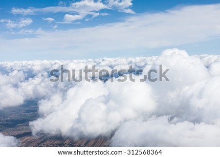 aerial view of village landscape  over the  clouds in Poland - stock photo