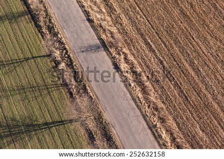 aerial view of village road and harvest fields in Poland