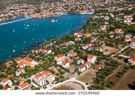 Aerial view of village Sukosan and marina Dalmacija, Croatia, Dalmatia county with islands in the background. - stock photo