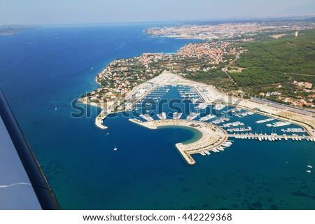 Aerial view of village Sukosan and marina Dalmacija, Croatia. Dalmatia county with islands in the background. - stock photo