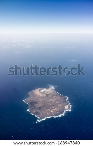 aerial view of volcanic island Isla de Alegranza in Lanzarote - stock photo
