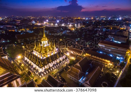 Aerial view of Wat Ratchanatdaram a Beautiful temple at twilight time, the temple is best known for the Loha Prasat famous landmark for tourist in Bangkok,Thailand - stock photo