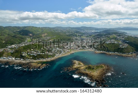 Aerial View of Wellington City from Island Bay. In the foreground are the southern suburbs with the city and harbour in the background. - stock photo