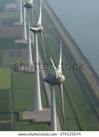 Aerial view of wind turbine farm at the coastline of the IJsselmeer, The Netherlands.  - stock photo