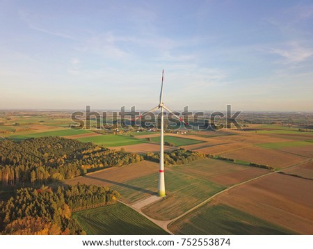 Aerial view of wind turbine in the middle of fields