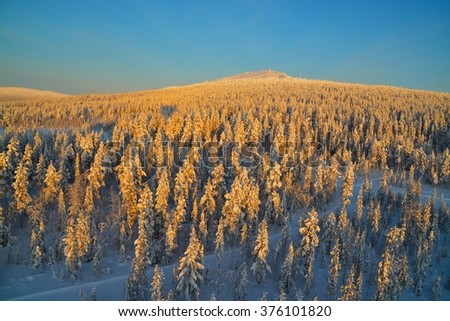 Aerial view of winter scenery, Finland during sunrise - stock photo