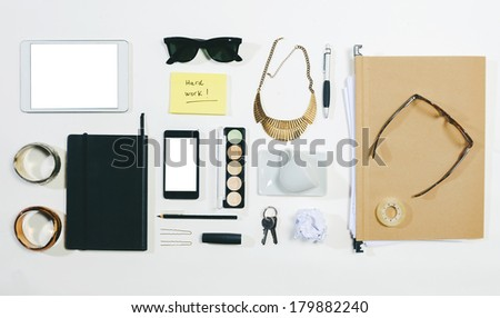 Aerial view of woman essentials at office./Overhead of business woman accessories.