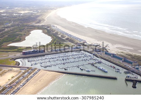 Aerial view of yacht harbor with beach of IJmuiden, The Netherlands - stock photo