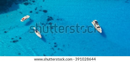 Aerial view of yachts in azure sea - stock photo