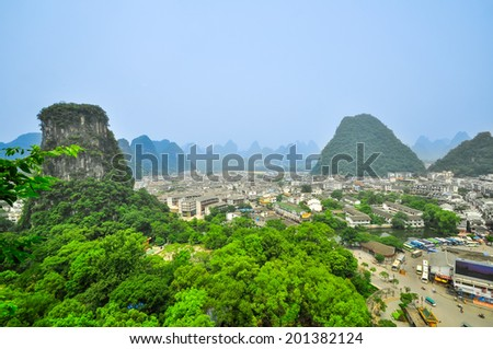 Aerial view of yangshuo city county town, beautiful karst mountain scenery,China - stock photo