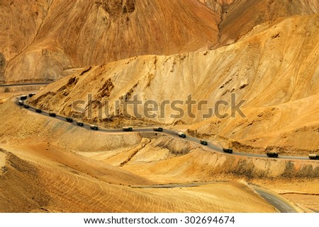 Aerial view of Zigzag road - famously known as jilabi road at old route of  Leh Srinagar Highway, trucks passing, Ladakh, Jammu and Kashmir, India - stock photo