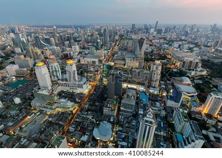 Aerial view office building and business downtown before sunset - stock photo