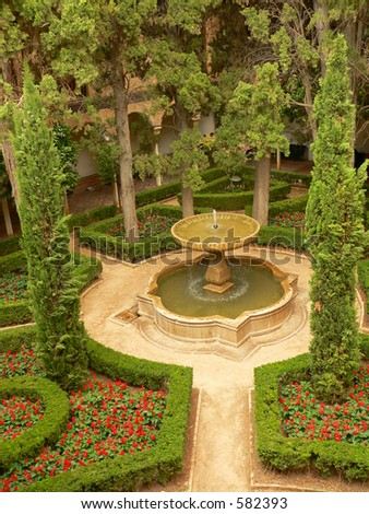 Aerial view oh parc with fount in Alhambra, Granada, Spain.