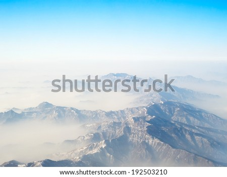 Aerial view on a mountains from the plane - stock photo