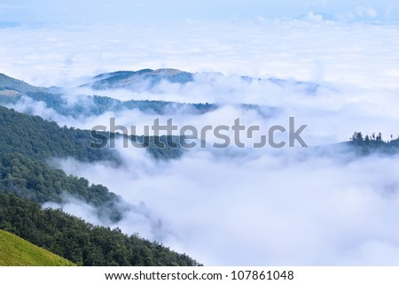 Aerial view on Carpathian mountains covered with clouds - stock photo