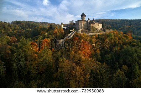 Aerial view on  Castle Sovinec, Eulenburg, robust medieval fortress, one of the largest in Moravia, Czech republic. Czech landscape with medieval castle on a rocky hill above a forest valley, autumn.
