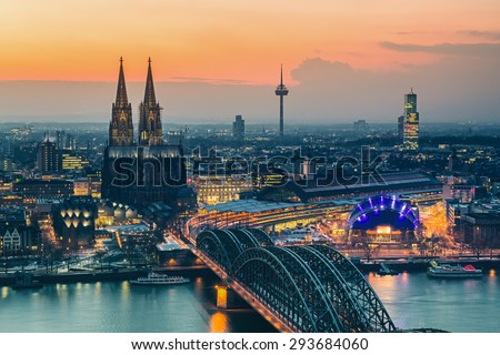 Aerial view on Cologne at dusk - stock photo