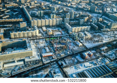 Aerial view on construction site in the city at sunny winter day