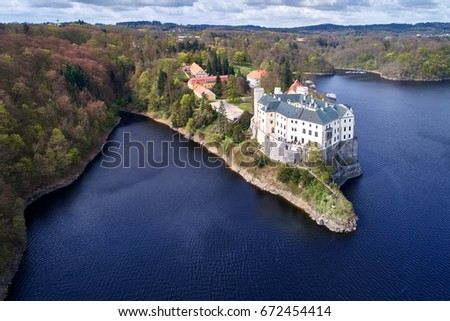 Aerial view on czech romantic, gothic chateâu Orlik, situated on rock outcrop above  Orlik reservoir in beautiful spring nature. Romantic,royal Schwarzenberg castle above water level. Czech landscape.
