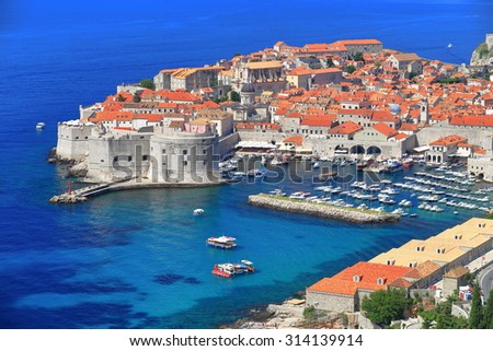 Aerial view on distant walls and and harbor of Dubrovnik, Croatia - stock photo