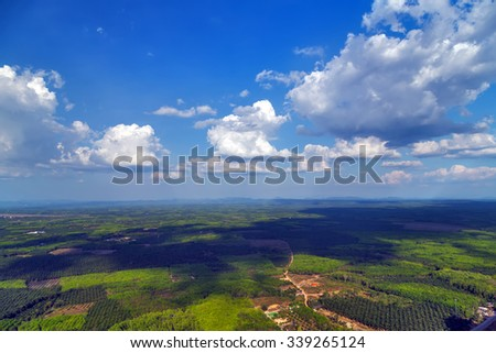 Aerial view on green jungle and blue sky landscape tropical - stock photo