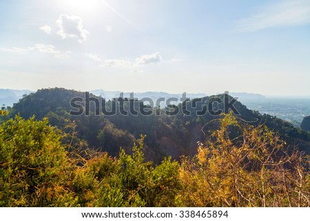 Aerial view on green jungle mountain and blue sky landscape tropical - stock photo