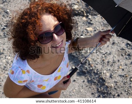 Aerial view on happy women with umbrella in summer day