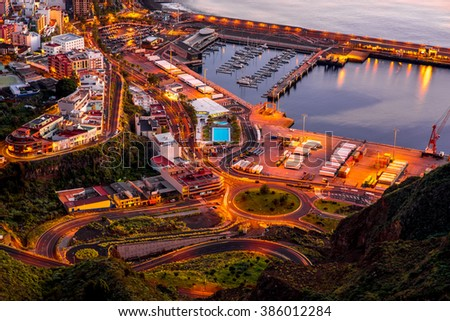 Aerial view on illuminated Santa Cruz city on the dusk on La Palma island in Spain - stock photo