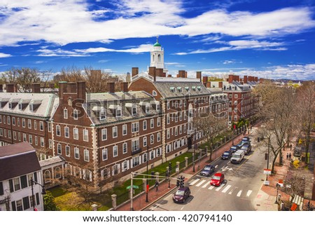 Aerial view on John Kennedy Street in the Harvard University Area in Cambridge, Massachusetts, the USA. Eliot House white belltower seen on the background. Tourists in the street - stock photo