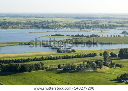 Aerial view on lock in the river Rhine in Holland - stock photo