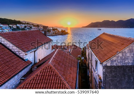 Aerial view on mediterranean town Korcula during sunset time, european famous places. / Korcula rooftops aerial sunset. / Selective focus, intentional underexposed areas.