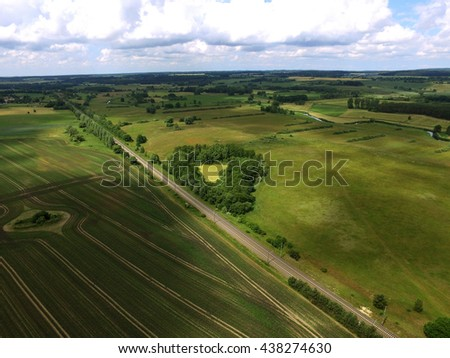 aerial view on railway tracks between agriculture fields in germany