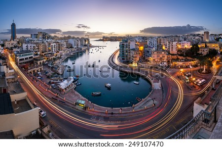 Aerial View on Saint Julien and Spinola Bay at Dawn, Malta - stock photo