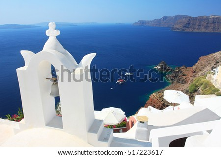 Aerial view on Santorini's caldera with traditional cycladic belfry, Greece