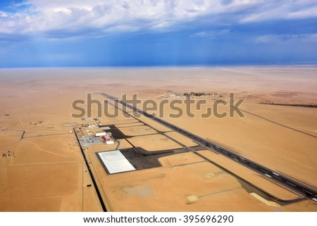 Aerial view on the runway of a small airfield in the Namib Desert in Swakopmund area, Namibia, Africa - stock photo