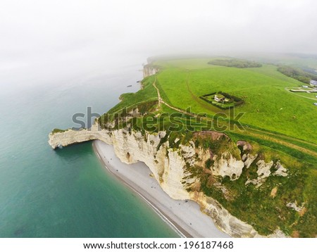Aerial view on the steep coast of Normandy near the town of Etretat - stock photo