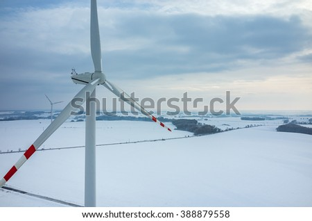 Aerial view on the windmill on the field in winter season